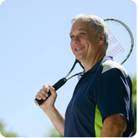 man with tennis racket image